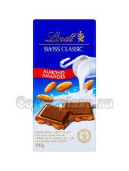Плитка Lindt Milch-Mandel шоколад  c цельно обжаренным миндалем100 г